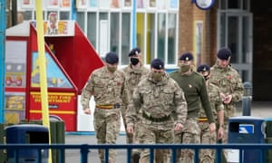 Soldiers arrive at Pontins by Ainsdale beach, Southport, Merseyside on Thursday to set up a mass Covid-19 testing facility.