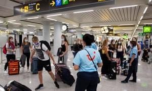 Representatives of tour operator Tui provide information to British tourists at the airport in Palma de Mallorca.