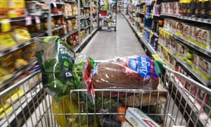A shopping trolley is seen alongside available perishable goods in a supermarket in Sydney