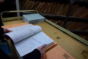 An employee shows a copy of records