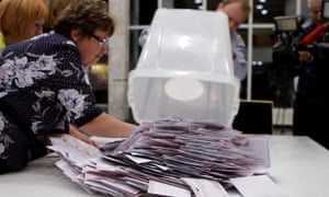 Officials count ballot papers in Latvia's general election.
