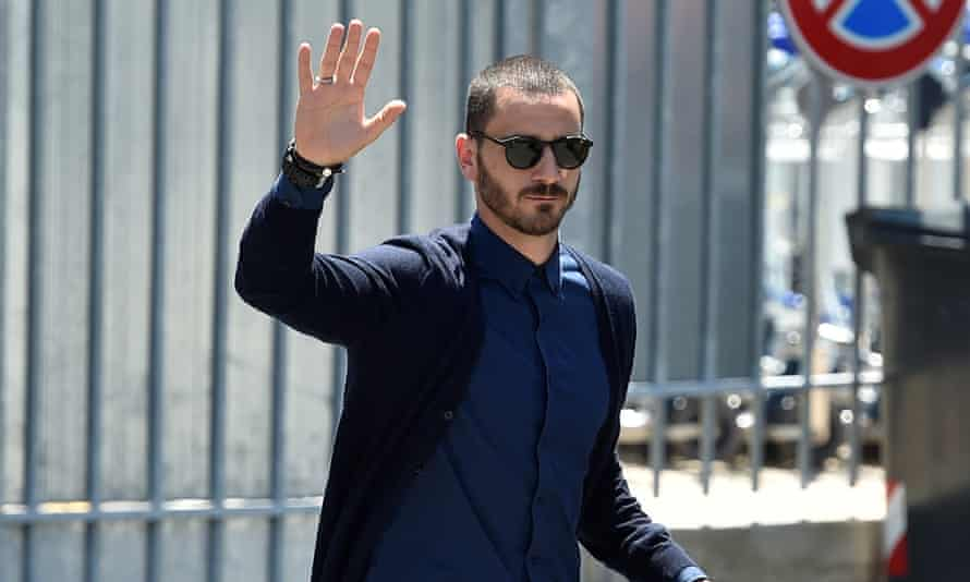 Juventus' player Leonardo Bonucci waves as he arrives at the Caselle airport in Turin.