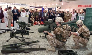 British soldiers display the use of their weapons at an arms exhibition in Abu Dhabi.