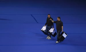 Workers begin carry ballots after polling stations closed in the Referendum on the European Union in Glasgow.