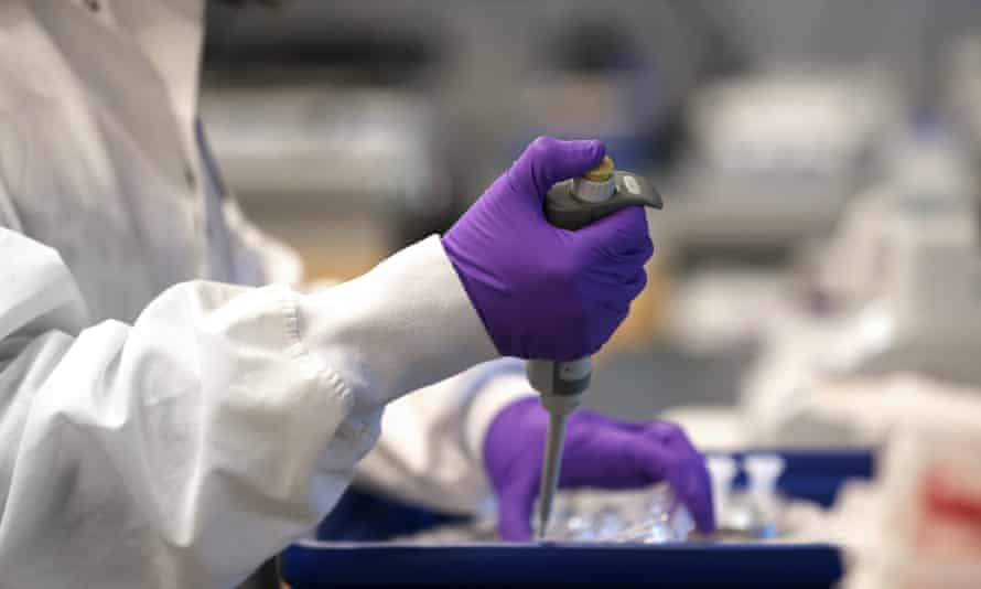 A researcher conducts tests at the Moderna labs in Cambridge, Massachusetts.