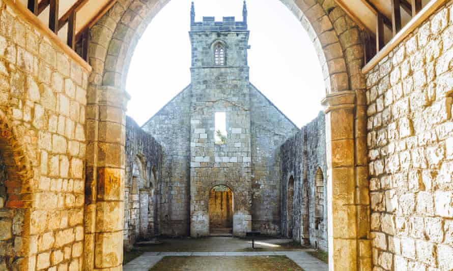 archway and church tower, village of Wharram Percy