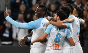 Mario Balotelli, left, hit the headlines last season after celebrating a goal for Marseille by taking a selfie with some of his teammates.