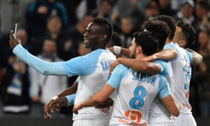 Mario Balotelli films himself with teammates after scoring for Marseille in the win against Saint-Etienne.
