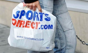 A person holding a Sports Direct bag