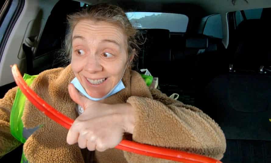 Volunteer … Karen Dunbar delivers food parcels.
