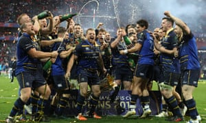 Leinster players savour their victory as they celebrate with the European Rugby Champions Cup Trophy.