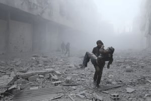 Arbin, SyriaA wounded man is carried following an airstrike on the rebel-held town of Arbin on the outskirts of the capital, Damascus.