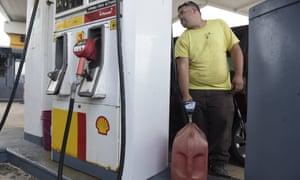Luis Fonseca fills a container with gasoline at a gas station one day before the forecasted arrival of Hurricane Maria in San Juan, Puerto Rico, Tuesday, Sept. 19, 2017. Authorities in the U.S. territory of Puerto Rico, which faces the possibility of a direct hit, warned that people in wooden or flimsy homes should find safe shelter before the storm's expected arrival there on Wednesday
