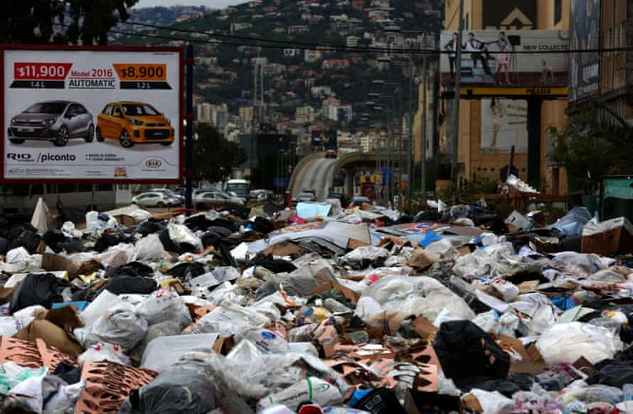 Garbage piles up at a temporary dump on the northern entrance of the Lebanese capital, Beirut, on 25 October