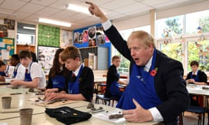 Boris Johnson participates in a school art lesson during a general election campaign visit to George Spencer Academy