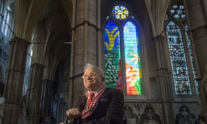 David Hockney sits in front of The Queen's Window, a new stained glass window at Westminster Abbey, London.