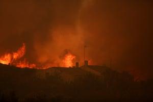 A fire burns near houses in Pedreira
