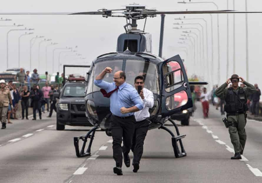 Wilson Witzel celebrates after a police sniper killed the kidnapper who held the occupants of a bus hostage on the Rio-Niteroi bridge, in Rio de Janeiro, Brazil on 20 August 2019.