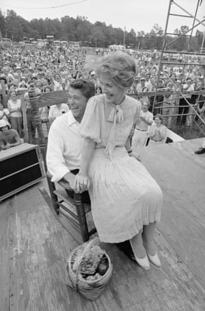 Ronald Reagan and wife Nancy share a chuckle as they try a rocking chair presented during their visit to the Neshoba County Fair.