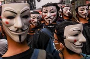 Protesters wearing Guy Fawkes masks take part in a demonstration against the emergency regulations ordinance.