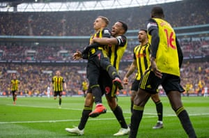 Gerard Deulofeu is embraced by Troy Deeney after scoring his second goal to put Watford 3-2 in front in extra time and secure their place in the final against Manchester City.