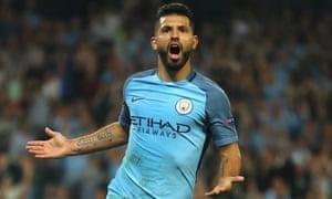 Sergio Aguero celebrates scoring his, and Manchester City's third.