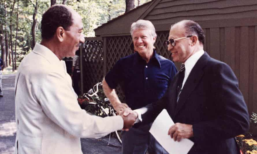 President Anwar Sadat of Egypt, left, shaking hands with Israeli Prime Minister Menachem Begin of Israel, with Jimmy Carter looking on at the US presidential retreat at Camp David, Maryland, in 1978, before the announcement of the historic peace accords the following year.