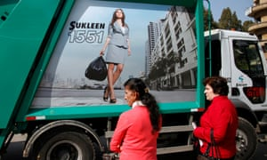 Two women, one from from Lebanon and one from Sri Lanka wait for a bus in Beirut, Lebanon