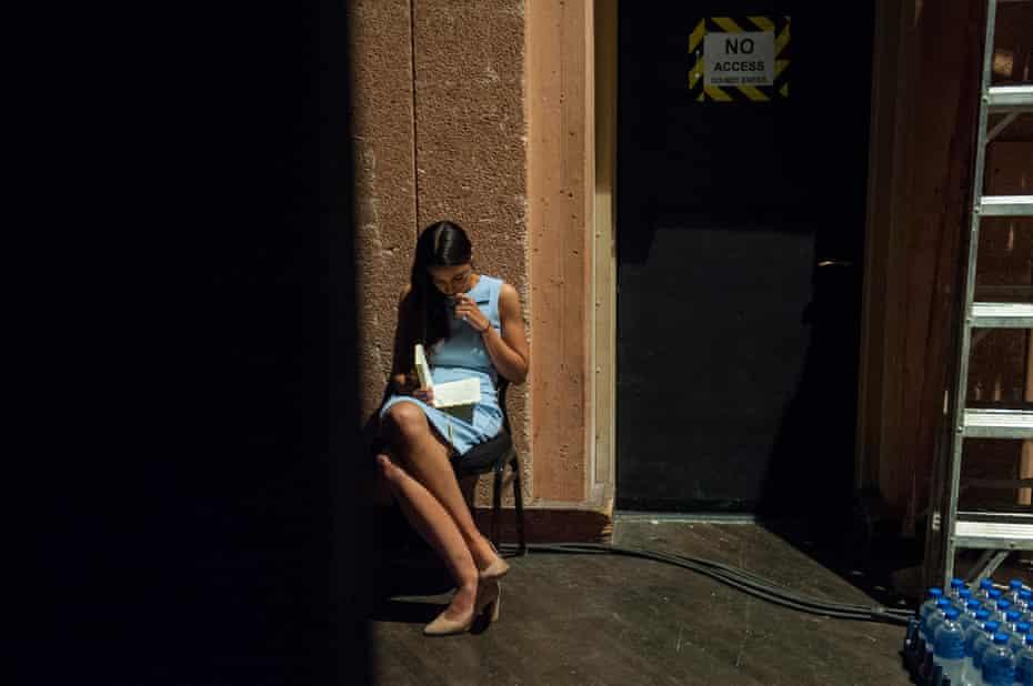 Alexandria Ocasio-Cortez reviews her notes backstage.