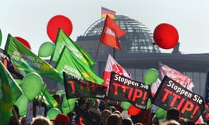 Potesters against the TTIP trade deal carry banners and balloons in Berlin on Saturday.