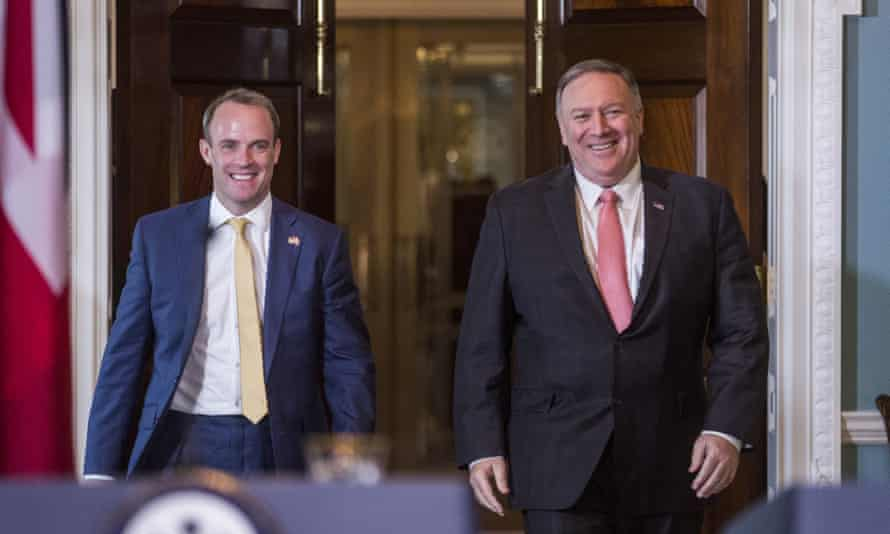 Dominic Raab, left, and Mike Pompeo arrive before speaking during a joint press event on Wednesday.