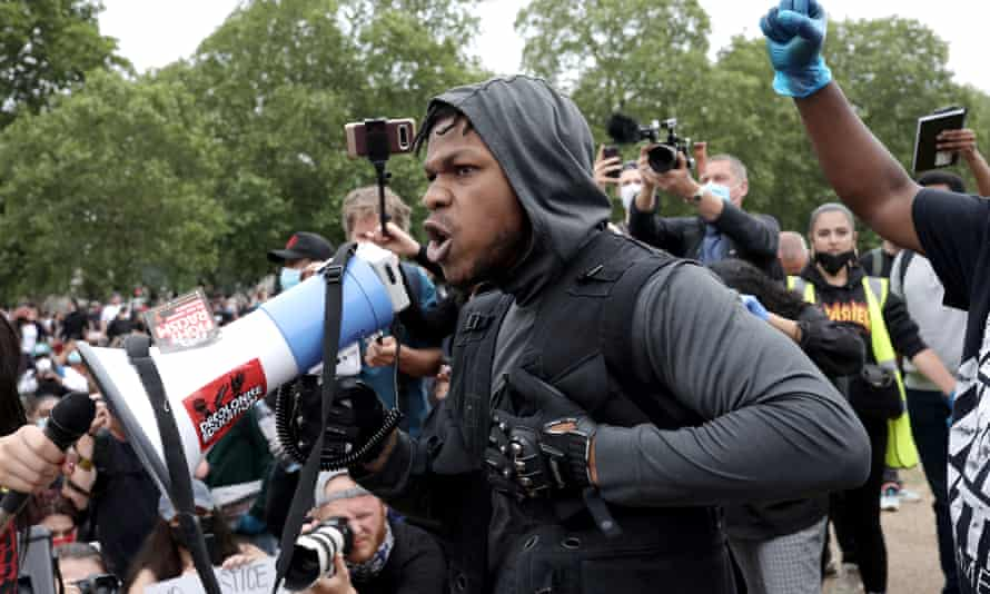 Actor John Boyega speaks to the crowd during a Black Lives Matter protest in Hyde Park in London.