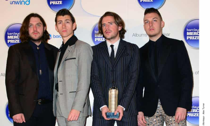 Nick O'Malley, far left, and the rest of the Arctic Monkeys at the Barclaycard Mercury Prize 2013 at the Roundhouse, London.