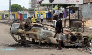 A burnt out car in Kinshasa