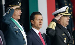 Mexico's President Enrique Pena Nieto (centre) during a military parade in celebration of the 104th anniversary of the Mexican Revolution in November.