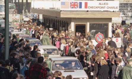 West Berliners welcome East German cars crossing Checkpoint Charlie in 1989