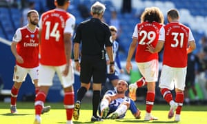 Neal Maupay of Brighton and Hove Albion reacts after being confronted by Matteo Guendouzi of Arsenal.