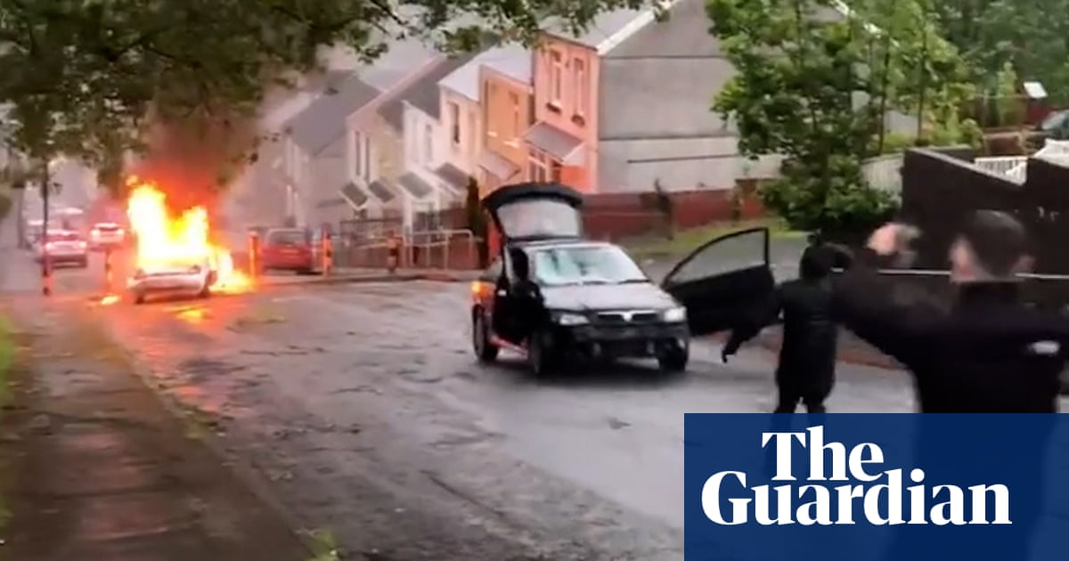 Rioters set cars ablaze as violence breaks out at Swansea vigil – video