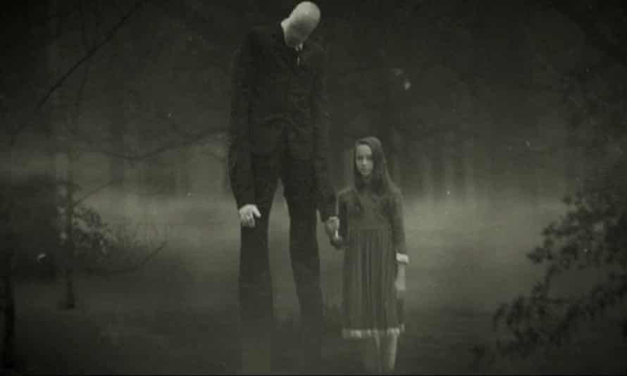 Still from Beware the Slenderman shows a tall man holding a little girl's hand