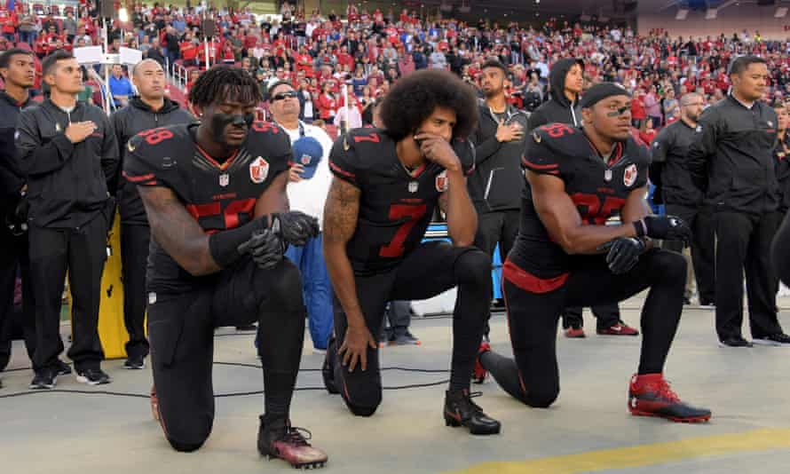 San Francisco 49ers players Eli Harold, Colin Kaepernick and Eric Reid kneel in protest during the playing of the national anthem before a game on 6 October 2016.