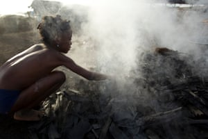 A girl sifts hot charcoal with her bare hands at a production site on the outskirts of San Pédro in the Bas-Sassandra region. Adults and out-of-school children work seven days a week at the site – where they are exposed to dangerous smoke and charcoal fumes throughout the day.