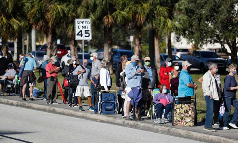 Seniors and first responders wait in line to receive a Covid-19 vaccine in Florida, one of the most popular 'vaccine tourism' destinations.