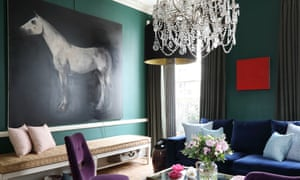 Bold colours: green paint contrasts with the midnight blue velvet sofas in interior designer Ana Engelhorn's home.