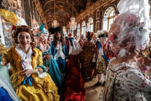 People take part in a fancy dress evening in the Hall of Mirrors at the Palace of Versailles in France