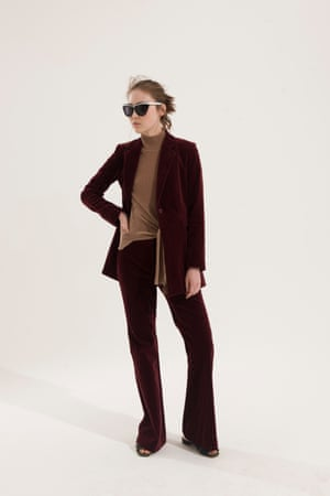 maroon jacket and trousers, Theory,  waist tied beige jumper, Whistles, slip on shoes Kurt Geiger, sunglasses with white arms
