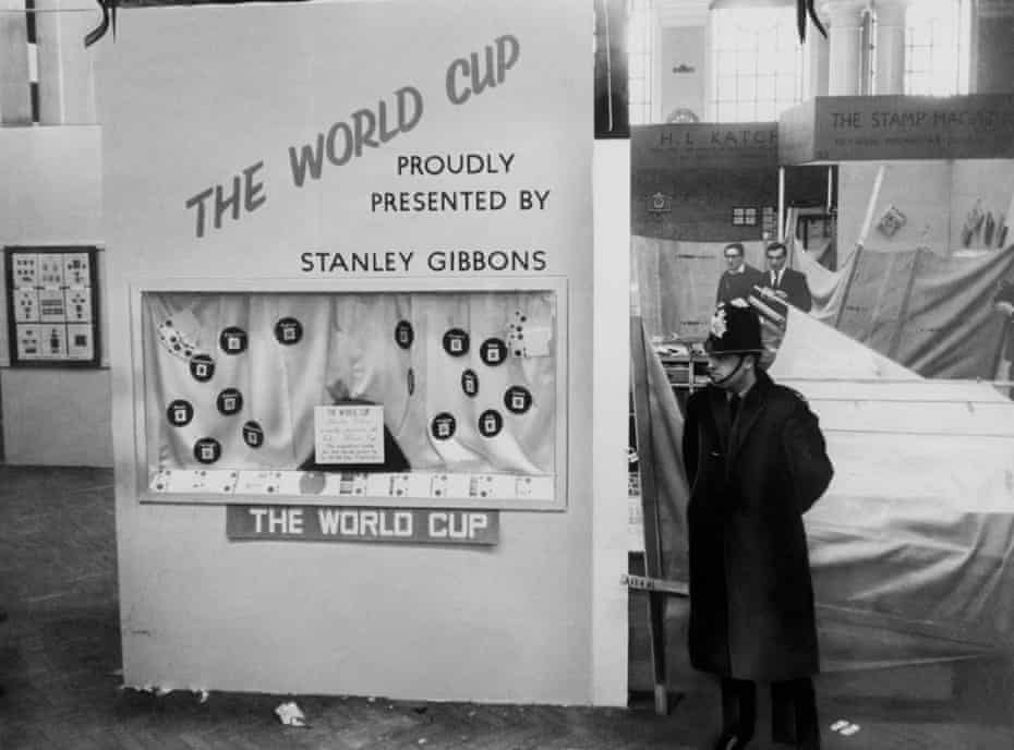 A policeman stands guard in Central Hall, next to the stand at the National Stamp Exhibition where the Jules Rimet trophy was housed before it was stolen.