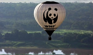 A World Wide Fund for Nature hot air balloon over the Amazon river and surrounding rainforest in Manaus, northern Brazil