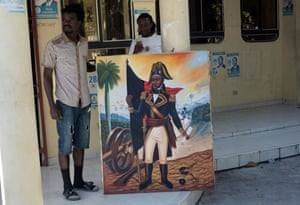 Activists with a portrait of Dessalines.