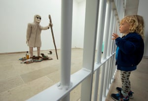 A young girl looks at The Rat Woman, Mondo Cane, part of the Belgian pavilion at the 58th Venice Biennale