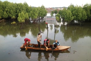 Environmental activists clean a nearby waterway